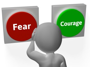 Fear Courage Buttons Showing Scary Or Unafraid